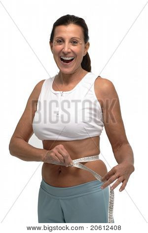 Happy woman in sport wear after losing weight