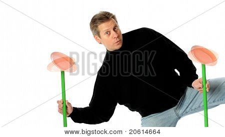Man Juggles Spinning Plates