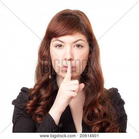 Beautiful business woman shushing on an isolated white background