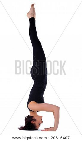 woman doing yoga exercise - head stand