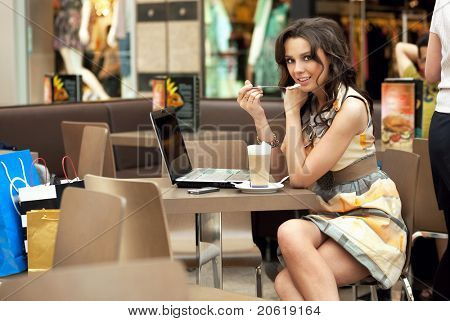 Beauty woman working on her laptop