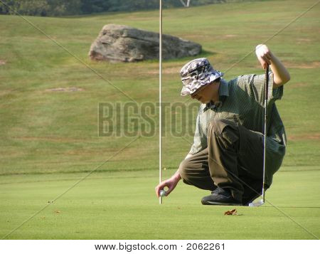 Young Man Golfing At A Golf Course