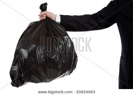 Un hombre de negocios o a los banqueros brazo sosteniendo una bolsa negra de basura - tema de deudas incobrables, malas inversiones, mal