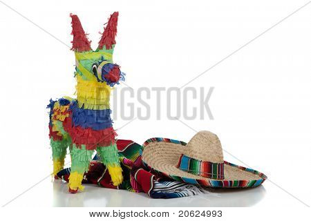 Mexican Serape, sombrero and pinata on a white background with copy space