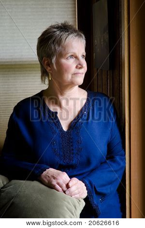 Older Woman By Window Light