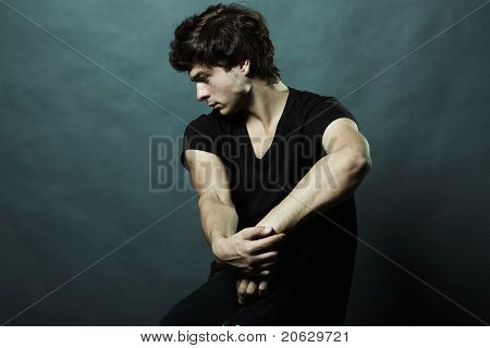 Fashion Portrait Of The Young Sexual Man