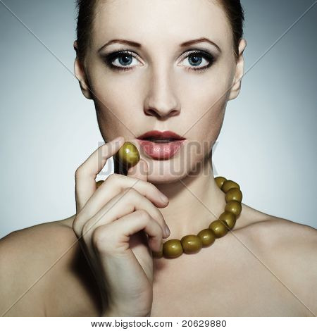 Portrait Of The Young Beautiful Woman With Olives