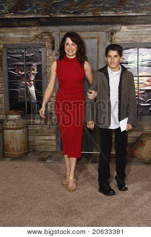 LOS ANGELES - FEB 14:  Alanna Ubach and her nephew Alex arrive at the premiere of 'Rango' on February 14, 2011 at the Regency Village Theater in Los Angeles, CA.