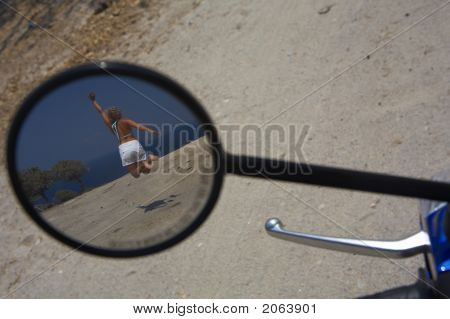 Girl In A Motorbike Mirror Jumping Up