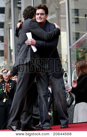 LOS ANGELES - MAR 12:  Charlie Sheen, Chuck Lorre at a ceremony as Television Producer Chuck Lorre is honored with a star on the Hollywood Walk of Fame in Los Angeles, CA on March 12, 2009