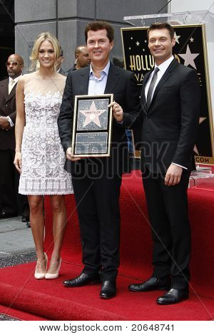 LOS ANGELES - MAY 23: Carrie Underwood, Simon Fuller, Ryan Seacrest at a ceremony where Simon Fuller receives a star in Los Angeles, California on May 23, 2011.