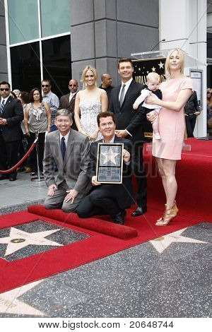 LOS ANGELES - MAY 23: Carrie Underwood, Simon Fuller, his wife and baby, Ryan Seacrest, Leron Gubler at a ceremony where Simon Fuller receives a star in Los Angeles, California on May 23, 2011.