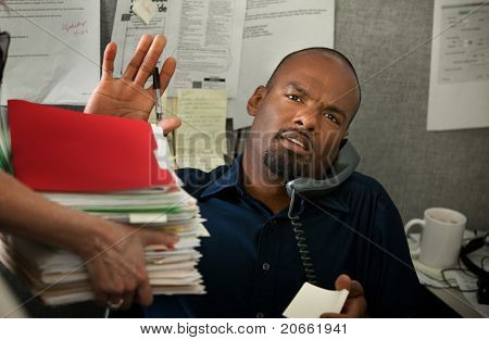 Overworked Man In Office
