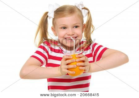 Lucky girl drinking orange juice through straw