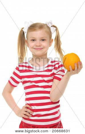 girl holding an orange and smiling