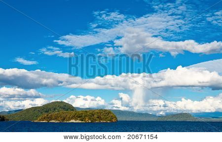 Cumulus cloudscape over the Lake Manapouri in the South Island of New Zealand