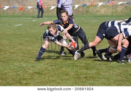 Player About To Pass The Ball After A Scrum In A Women's College Rugby Match