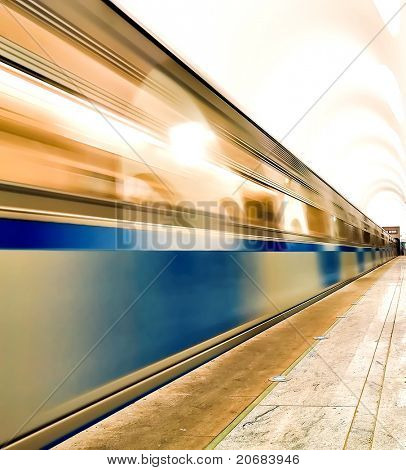underground platform with moving train