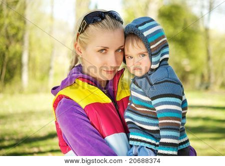 Mother with her adorable baby outdoors