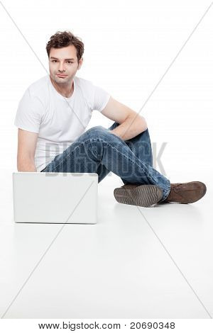 Man Sitting Behind Blanck Laptop
