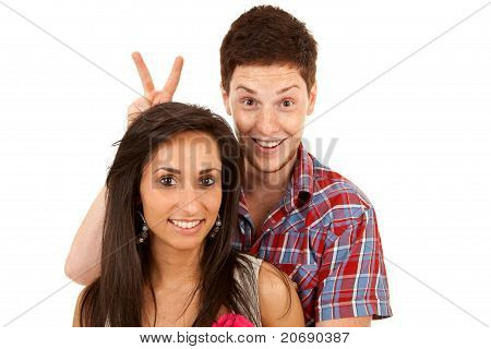 Man Goofing Around Behind His Girlfriend