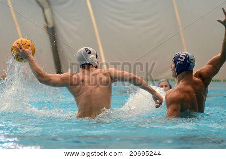 KAPOSVAR, HUNGARY - APRIL 16: Marton Bognar (in white) in action at a Hungarian national championship water-polo game between Kaposvari VK and Hegyvidek Ybl WPC on April 16, 2011 in Kaposvar, Hungary