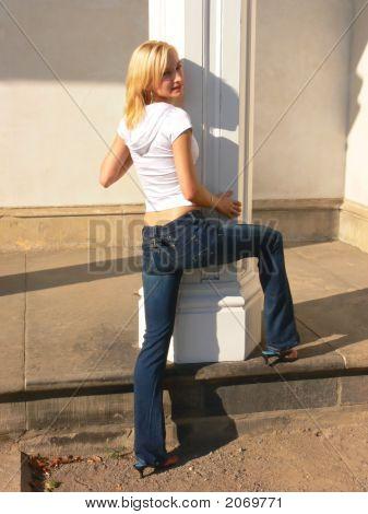 Blond Lady On White Column.