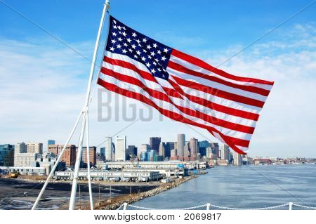 Flag Flying From Deck Of Uss Jfk With Boston Background