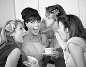 image of foursome  - Group of four excited housewives in a kitchen share secrets - JPG