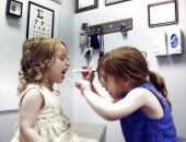 picture of medical doctors  - two little girls in a medical office playing doctor  - JPG