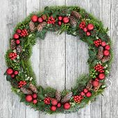 Christmas wreath decoration with red baubles, holly, mistletoe, pine cones, juniper fir, blue spruce poster