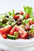 Healthy salad with tomatoes and olives poster
