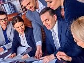 Business people office life of team people working with papers sitting table. Cabinets with folders  poster
