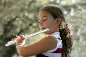 image of piccolo  - girl playing a flute - JPG