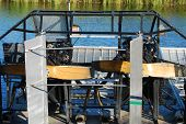 image of airboat  - Rear view of airboat awaiting passengers at swamp land - JPG