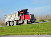 stock photo of dump_truck  - Heavy equipment truck delivering materials to job site - JPG