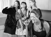 stock photo of puke  - Woman reacts to strong alcohol while friends smoke and drink in the kitchen - JPG
