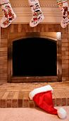 stock photo of cozy hearth  - Santa hat laying on fireplace hearth at Chirstmas - JPG