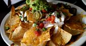 stock photo of nachos  - Deluxe Serving of Nachos Grande in Mexican Restaurant - JPG