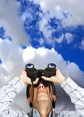 Business Man With Binoculars Over Sky poster