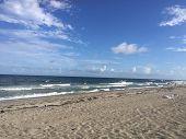 Waves Crashing On The Sand poster