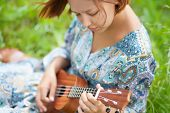 Young Woman Playing On Ukulele poster