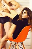 Cute Sexy Girl Put Legs On Torso Of Athletic Man poster