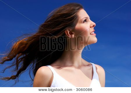Woman And Blue Sky