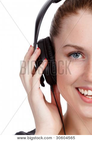 Pretty girl listening music and smiling to you. Isolated on white background.