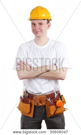 Young builder with helmet and tools isolated on white