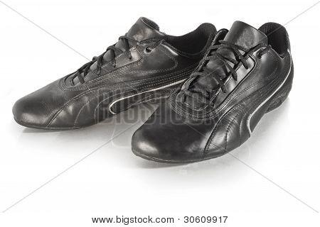 Worn Black Sneakers