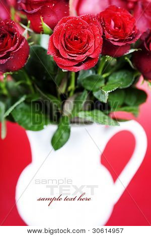 bouquet of red roses in vase (with sample text)