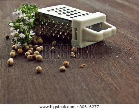 White pepper with grater and thymus