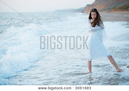 Woman In Sea Waves At Sunset